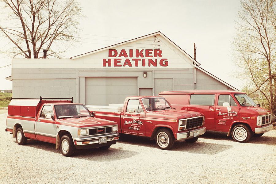 Daiker heating company building with service trucks